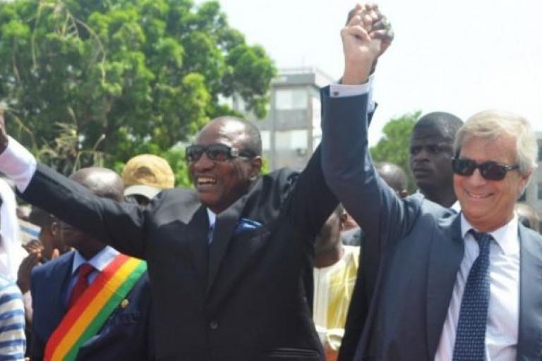 Le président guinéen Alpha Condé et l'industriel français Vincent Bolloré