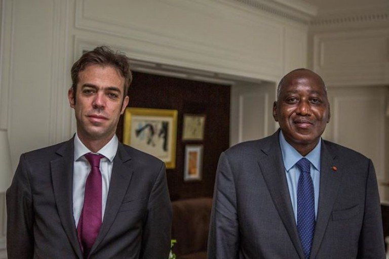 Le Premier ministre Amadou Gon et Franck Paris,  le Conseil Afrique de l'Elysée